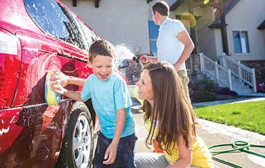 Image of children washing car