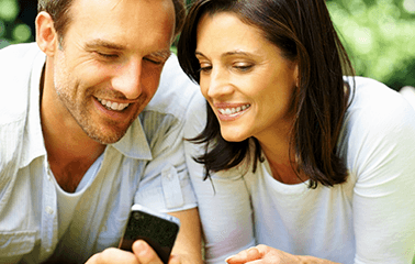 Image of younger couple looking at phone