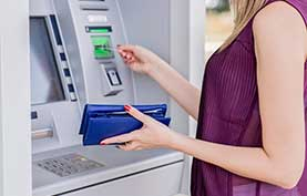 Image of women using ATM